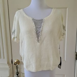 Jennifer Lopez cream color sweater with chains